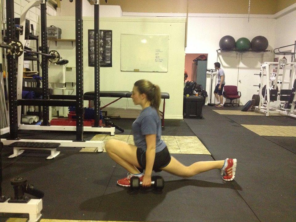 Elite Edge athlete Nicole Clarke demonstrates a proper split squat; one of our progressive exercises towards performing full squats