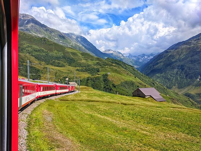 Swiss landscapes 😍🇨🇭🚞 . . #swissalps #switzerland #swiss #earth_shotz #earthfocus #earth #earthpix #earthpics #traveldiaries #travelers #trains #mountains #clouds #blueskies #mountainstones #wildernessculture #natgeoyourshot #nature #naturelovers #hills #summer #holiday #redtrain #andermatt