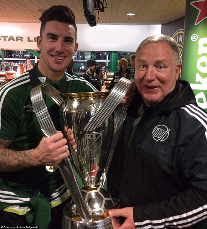 Bob and Liam holding the monumental Trophy