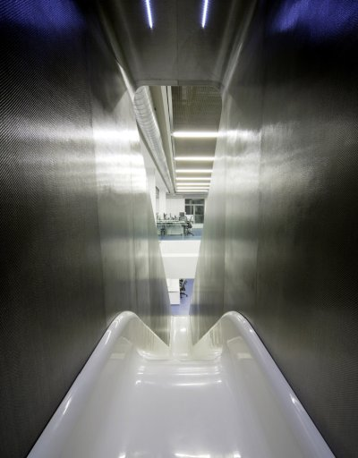 An awesome slide at Red Bull takes you from one level to another in the building!