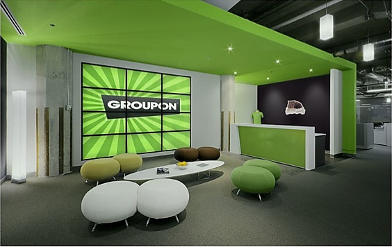 Bright colours, vinyl and modern decor feature throughout Groupon offices.