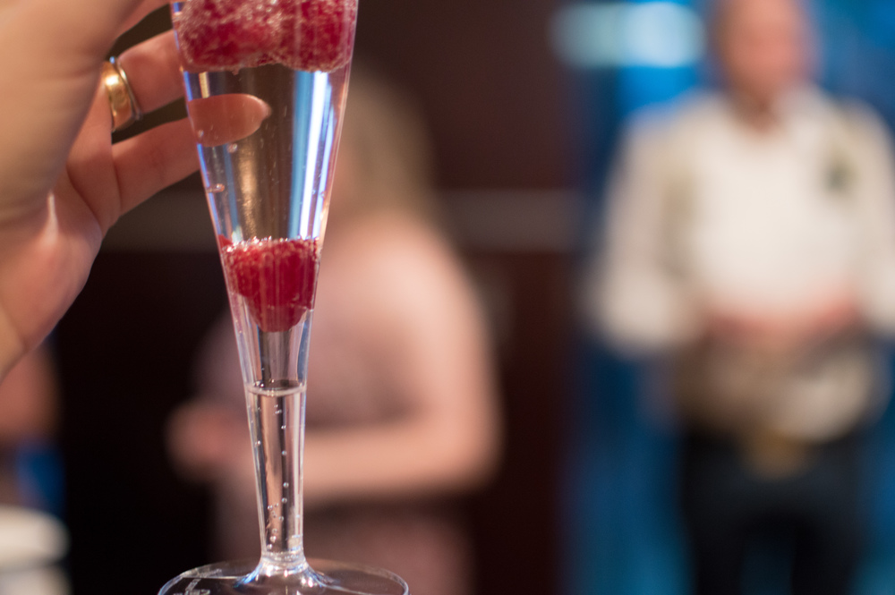 wedding reception raspberry champagne toast