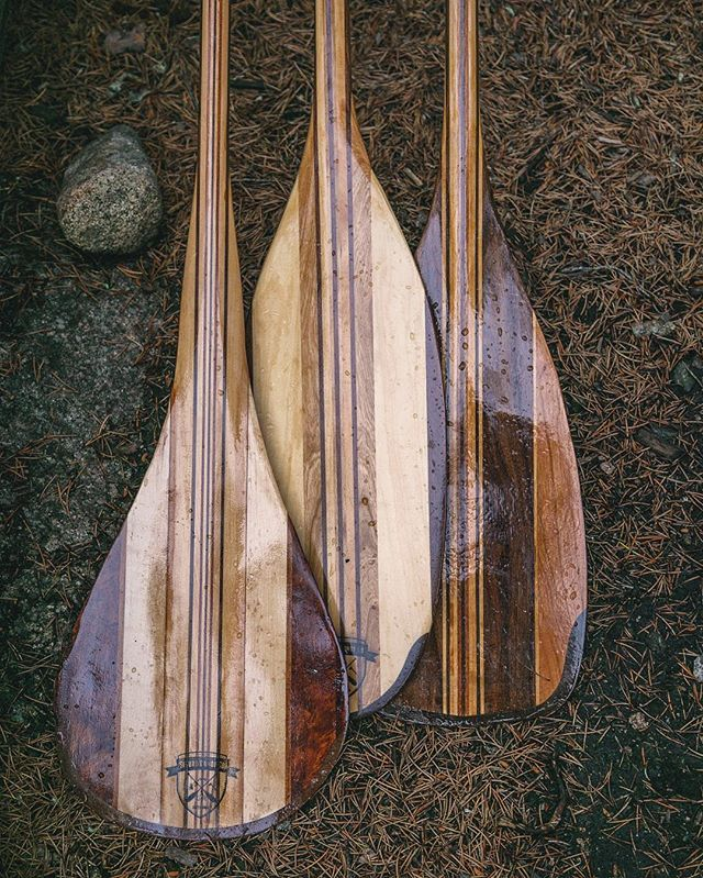 I love the way the water beads up on the paddles. Here are a few paddles resting on the banks of the boundary waters. #movewater #sigurdcanoeco #paddle #handmade