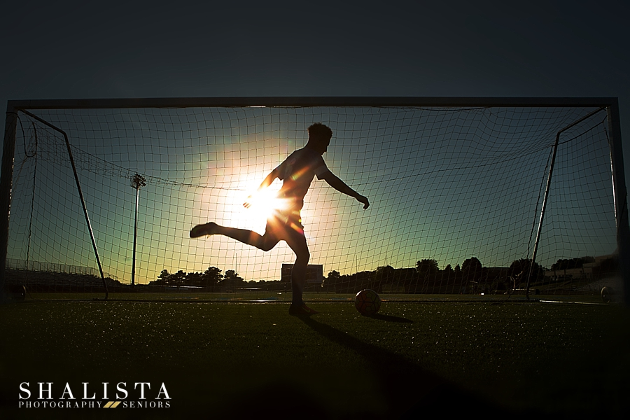 Soccer sunset action photo