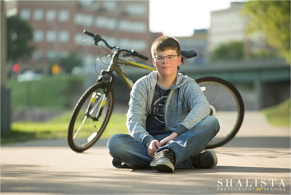 Senior boy with bike on bike trail