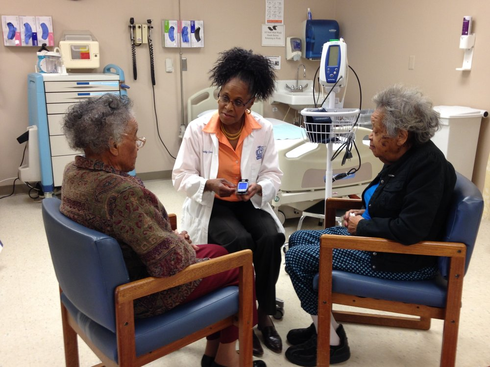 Medical Director, Dr. Gwendolyn Graddy with two of the participants in our program