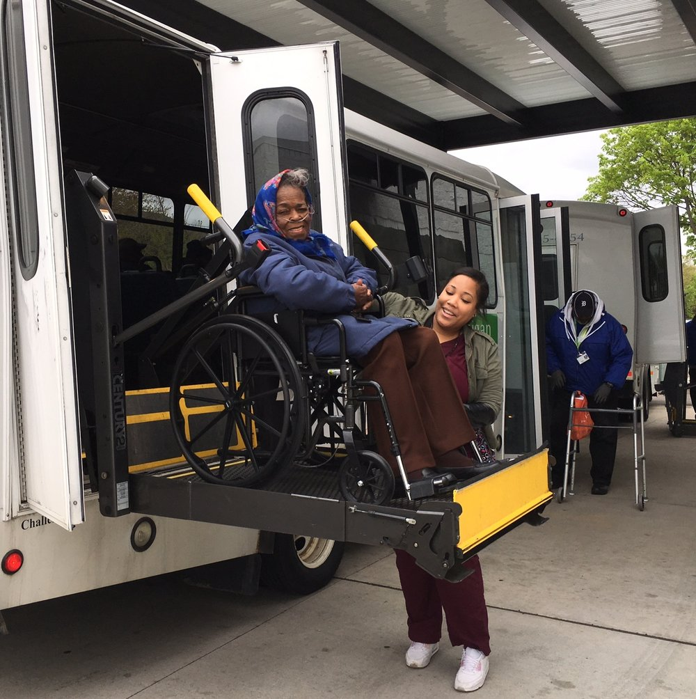 PCA and Participant getting on bus.jpg