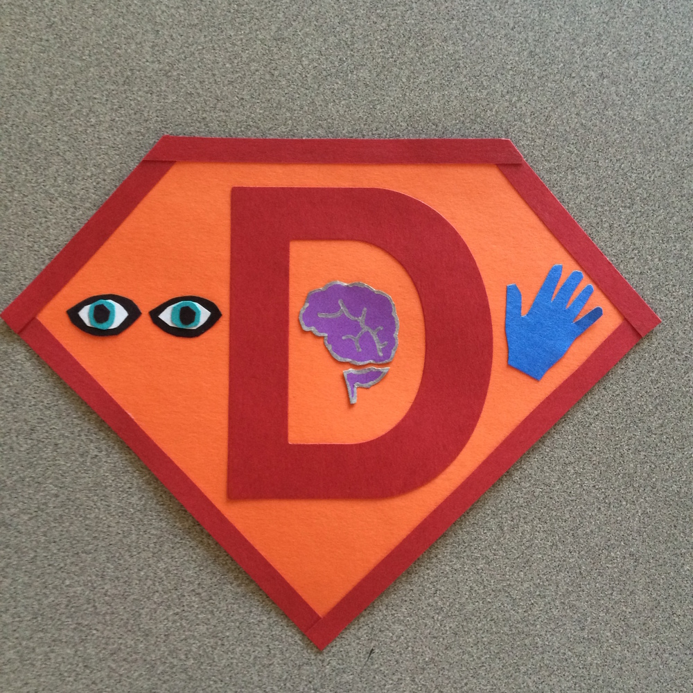 My superhero emblem: I see problems, think about them, and do something about them.