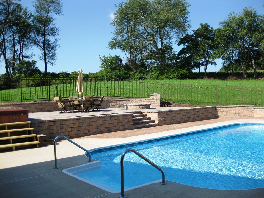 Custom Pool with EP Henry Hardscape Decking and Retaining Walls