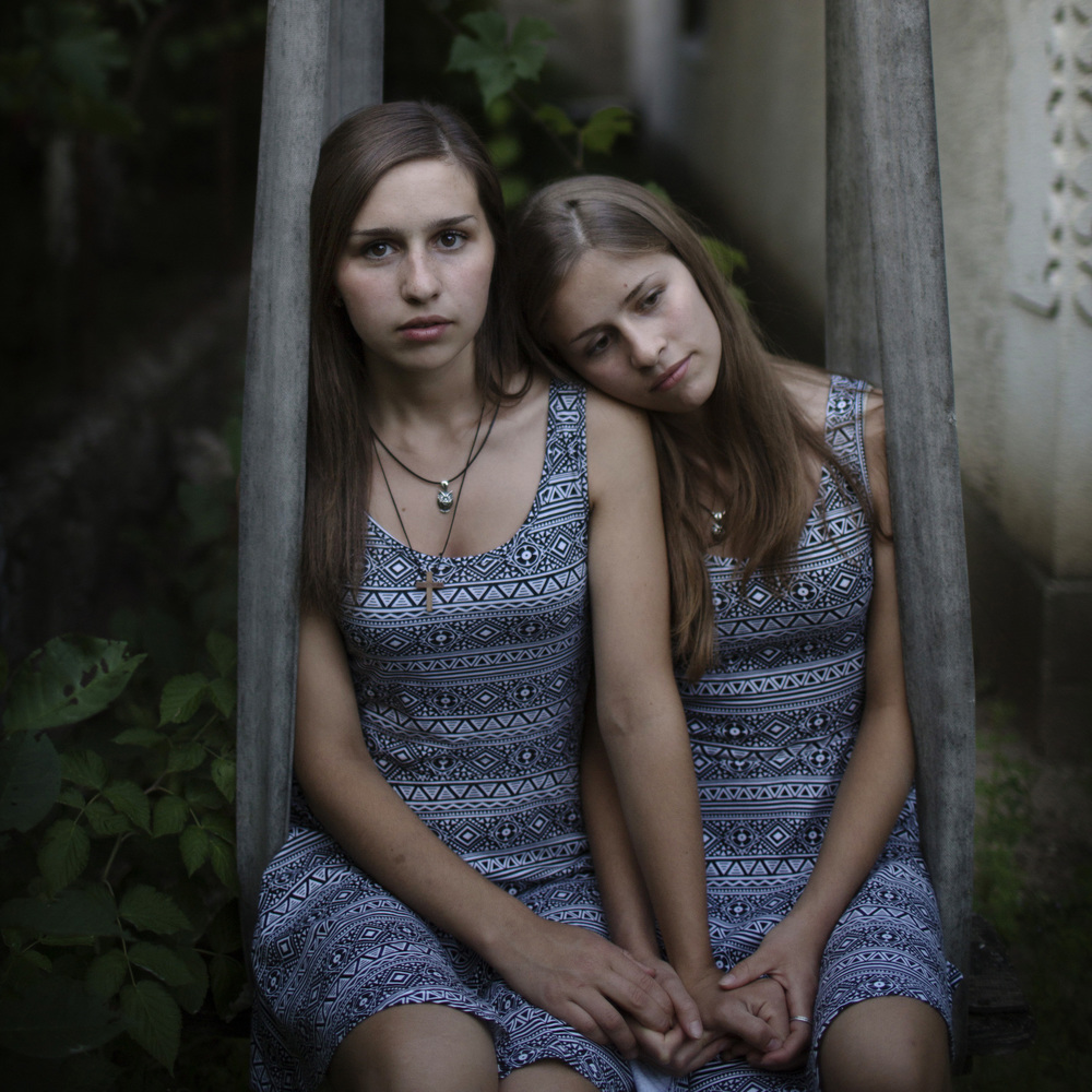 "Moldovan twins.  ""We like everything the same, we share the same dreams and love to watch Korean movies together. Five years ago we lost our older sister, we grieve for her and miss her, but now she is our guarding angel"".  Karina and Michaela Dumitrashuk don't see any future in Moldova. They share the same dream of a better life in Italy. This is from my latest project in Moldova on assignment for Festival Photoreporter in cooperation with World Press Photo.     On Thursday I will be on my way to St Brieuc for the yearly P  hotoreporter Festival in St Brieuc. The Moldovan twins is one of 16 images that I will exhibit at the festival, together with 9 other great photojournalists. Each photographer will share their own individual stories from all over the world."