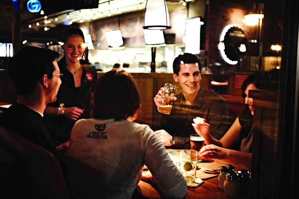 OC-Customers-Group-Drinking-Talking_Booth_Night3_300ppi.jpg