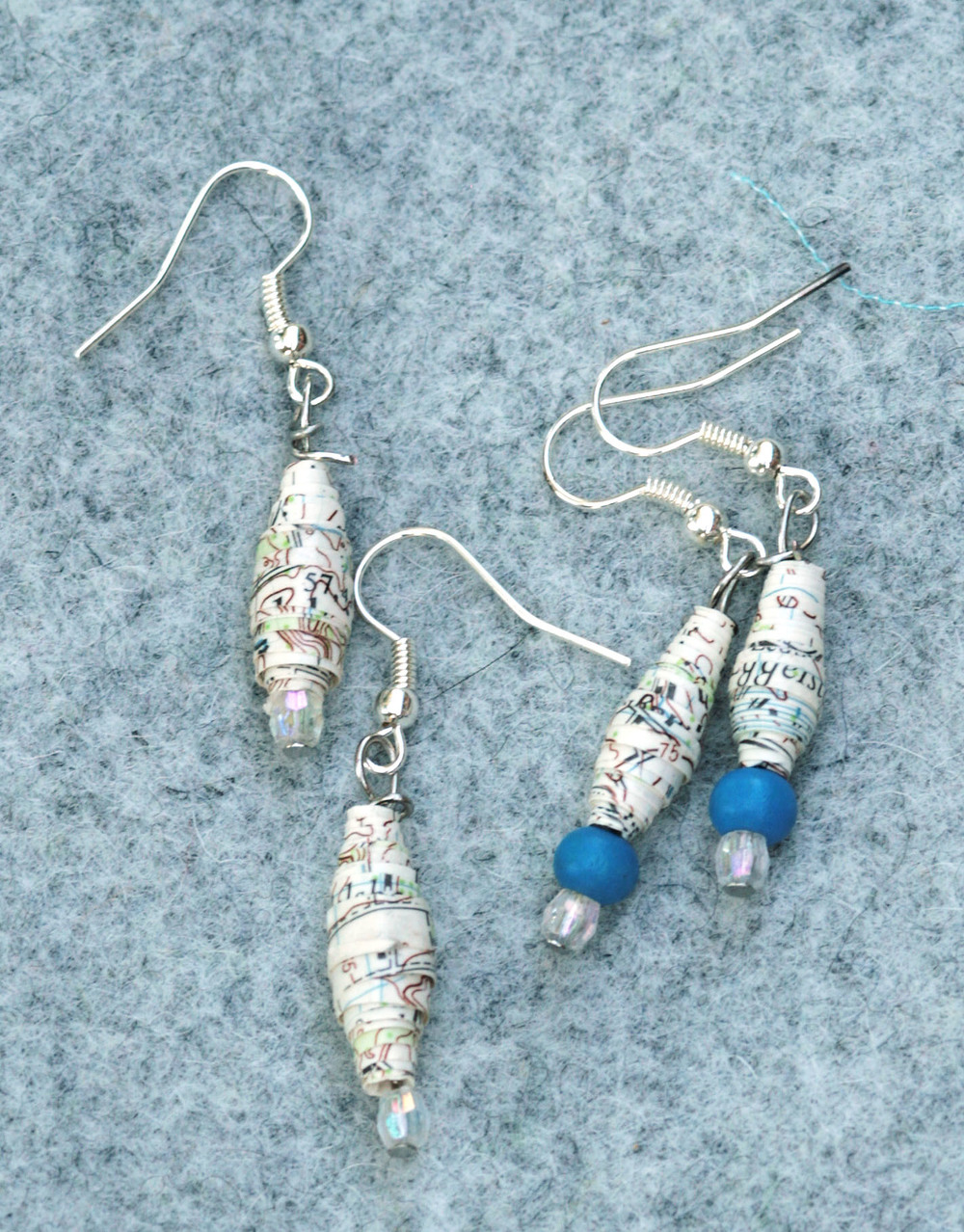 Earrings made of out of date maps.