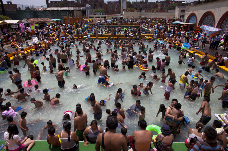 Residents of Mexico City, in an effort to mitigate heat waves. swim in a pool that was formerly fed by a natural spring source, It was converted into a public pool and filled with treated waters and made available throughout the summer, Las Termans in the district of Iztacalco, Mexico City no longer functions as such in order to save water in the capital.