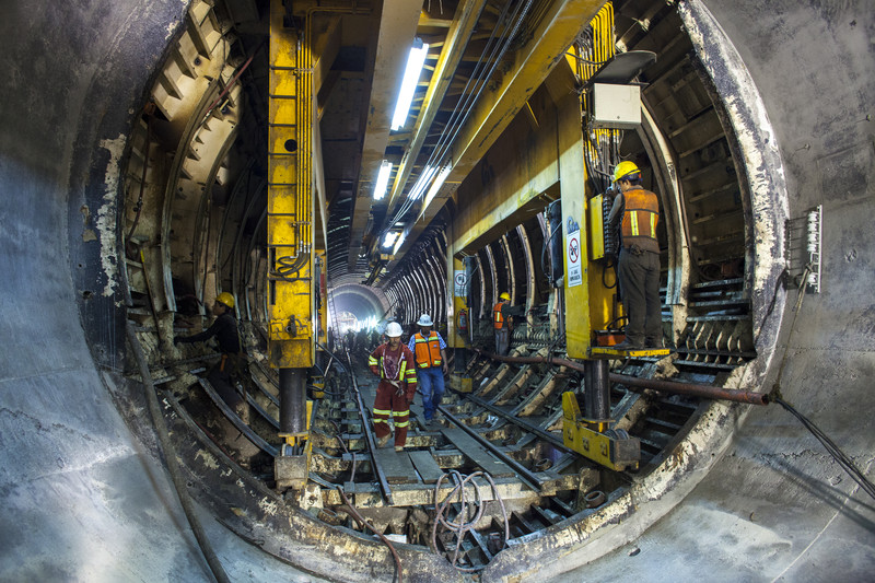 Workers operating and building walls with a boring machine inside what has been billed as the world's largest drainage tunnel, TEO (Tunel Emisor Oriente) will serve as an alternative to Mexico City's Emisor Central drainage tunnel, and will double the city's discharge capacity to 150m3/s to cope with heavy precipitation during the rainy season.