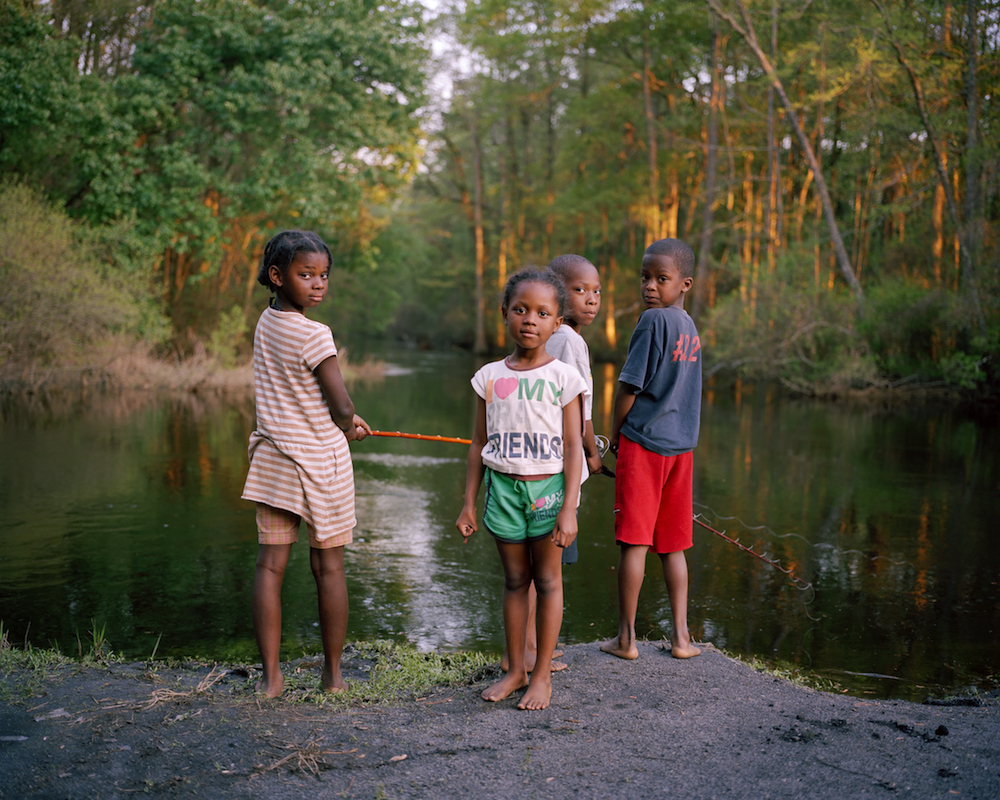 Brothers and sisters fishing, Lumber River bank, Wagram, NC