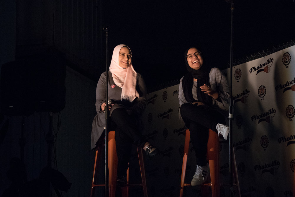 Dina Sayedahmed (left) and Hamna Saleem crack up during a Q&A with Ed Kashi after screening Hijabi World at Photoville's Opening Night. (Photo by Stephanie Khoury)
