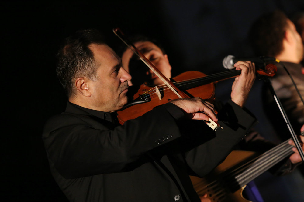 A violinist plays traditional Syrian music at Photoville's Opening Night presentation by Newest Americans. (Photo by Anthony Alvarez)