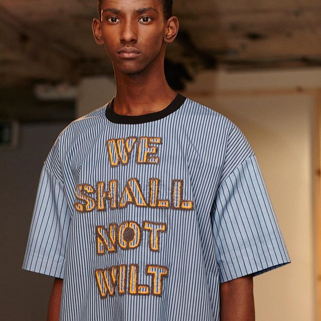 #BODYBOUND #SS18 #LFWM | WE SHALL NOT WILT | #Styling @wayperry_edit | #MU @adamdecruz | #Casting @natmonroe | #Hair @philipp_haug @toniandguyworld |#Model @myles_dominique98 @supamodelmanagement | @britishfashioncouncil @londonfashionweekmens | #Embroidered #Slogan #Resistance #LondonFashionWeek #Backstage |