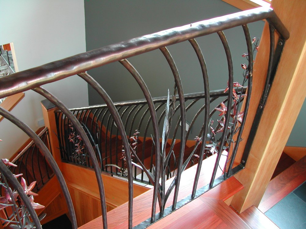 Railing top of stairs looking down.jpg
