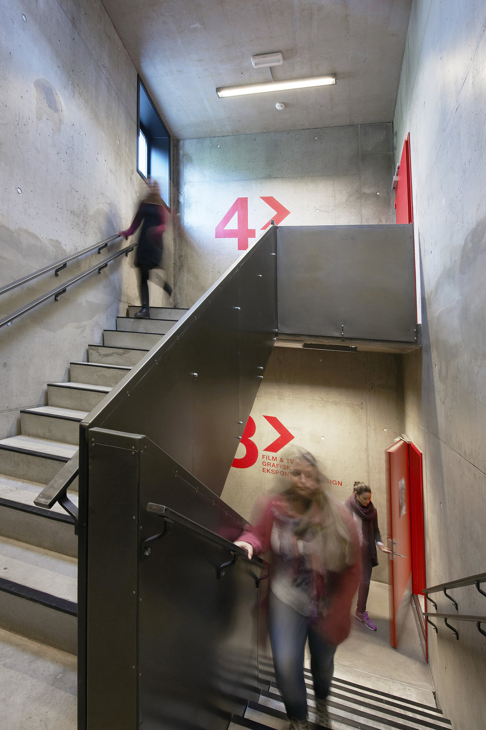 → Hand painted signage of floor numbers in the stairwell