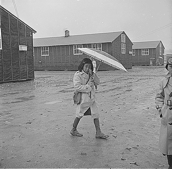 Trudging through the mud during rainy weather at the Jerome Relocation Center
