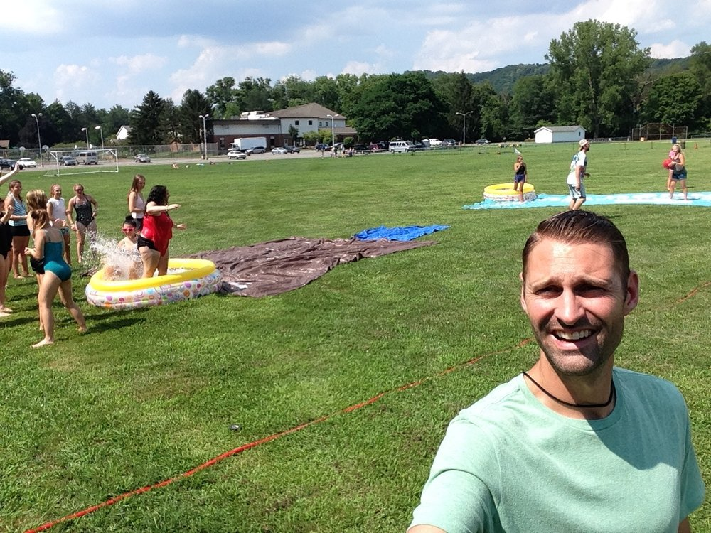 Out on my own with the students!  It's great to hear the campers having some fun during our free time activities.  This is a shot of our Slip and Slide kickball game!        Don't let my awkward grin distract you from the fun they're having!