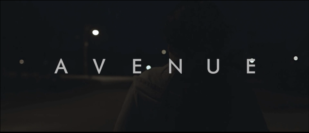 Avenue is the story of Michelle Pritchard, a young woman who has always had dreams of being an artist. However, any idea of a future is blurred as she takes care of her drunken father while they both deal with the loss of Michelle's mother. We follow Michelle as she struggles the choice of leaving her life behind, and staying close with her brother, or enduring her father for one more day. Conceived through writing workshops at the University of Alabama and formed over read-throughs in Los Angeles, CA, Avenue was later shot over a five-day period in Tuscaloosa, Alabama on location. It's completion is due to the successful crowd-sourcing done in a Kickstarter campaign in December 2014. The film stars Bailey Blaise-Mariea, Jon Headrick, and Brent Jones with Original songs by Raving Wild and Graham Iddon. Crew members include: Michael Thomas, Director & Cinematographer; Danny Ryan, 1st AD; Ellen Schwartz, Editor; John Wachs, 1st AC and Camera Operator; Tanner Robbins, Gaffer; Stephen Thomason, Production Designer; Stephen Thomley, Sound Mixer; Katie Tygielski, Boom Operator.