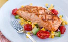 Ingredients: 4 ears fresh corn, kernels removed from cob 1 cup halved grape tomatoes 1/2 small avocado, diced 1/4 cup chopped red onion 1/4 cup chopped fresh cilantro 2 tablespoons extra-virgin olive oil 2 tablespoons champagne vinegar 2 tablespoons red wine vinegar Salmon 4 (4- to 6-ounce) boneless, skinless salmon fillets Canola spray oil 1/4 teaspoon fine sea salt 1/4 teaspoon ground black pepper Add ingredients to shopping listCreate a new list...  Method: Put corn, tomatoes, avocado, onion, cilantro, oil and vinegars into a large bowl and toss gently to combine. Set aside. Prepare a grill for medium heat cooking. Spray fillets all over with spray oil, then sprinkle on both sides with salt and pepper. Place fillets, skin-side up, on the grill. After about 2 minutes, turn salmon a quarter turn and cook 2 minutes longer. Flip and grill until cooked through, 4 to 5 minutes more. Remove salmon from the grill and top with corn and avocado salad. Nutritional Info: Per Serving:400 calories (180 from fat),20g total fat,3g saturated fat,80mg cholesterol,370mg sodium,24g carbohydrate(3g dietary fiber,8g sugar),33g protein
