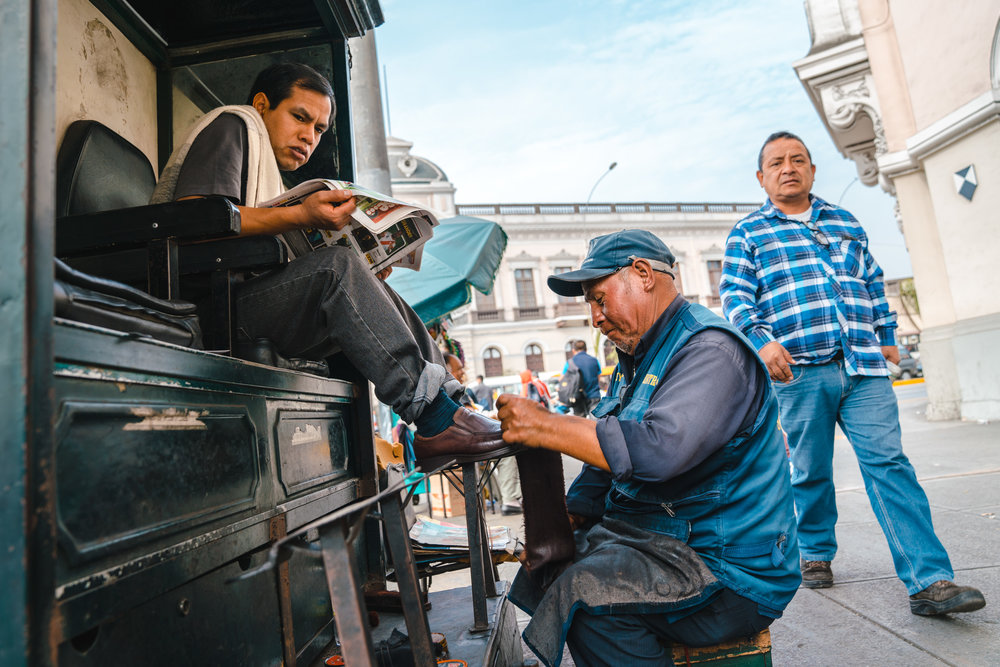 Shoe shining stall at the sit of the road in Downtown Lima, Peru. 2018