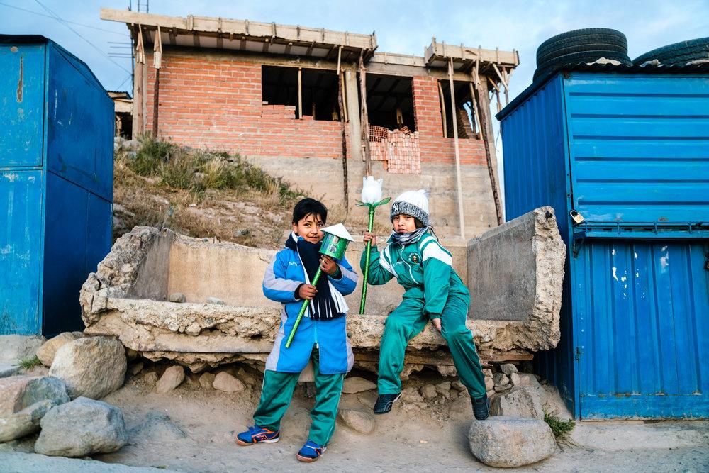 School children waiting for the bus. Potosi, Bolivia. 2018