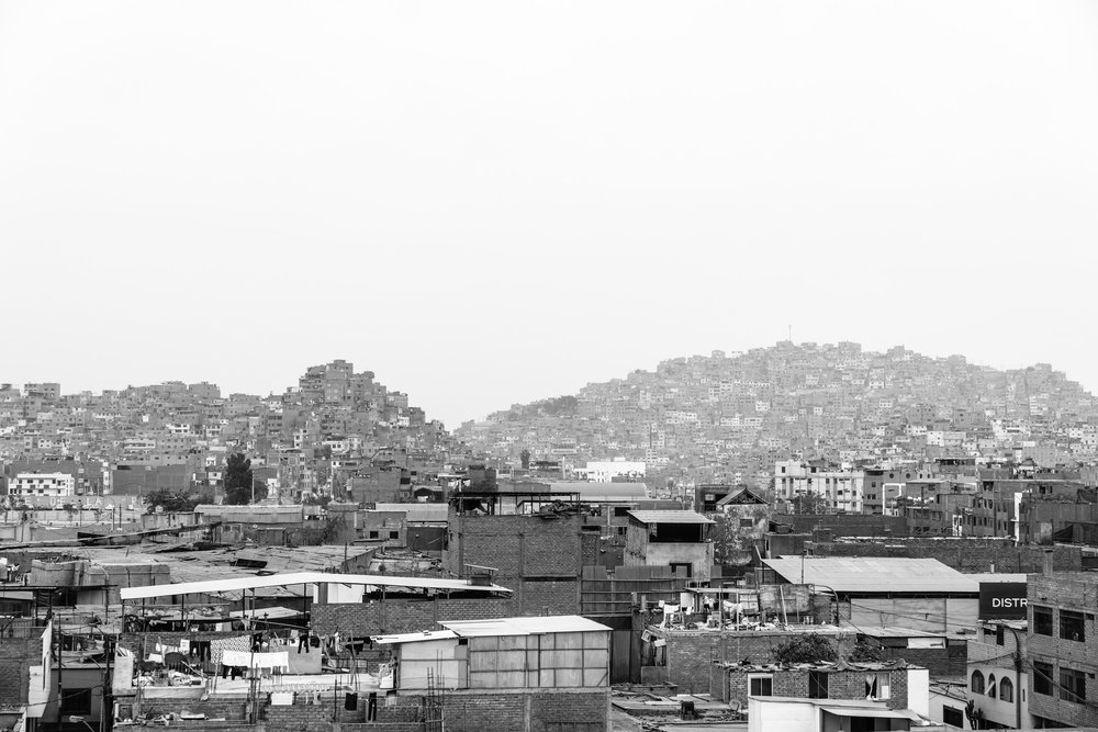 Hills covered with homes. Gamarra, Peru