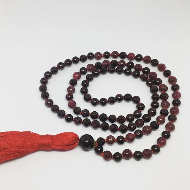 Surya Mala // Garnet & Ruby Gemstones - Garnet helps us feel connected and grounded in the present moment. Garnet allows you to unblock the channels that leave you feeling stuck and move you to your true state of joyful peace.  Ruby sustains and protects you leading you towards love while healing your past.  #gemstone #ruby #garnet #grounded #connected #heal #mala #gemstonemala #alignwithyoursoul #illuminatetheworld #align