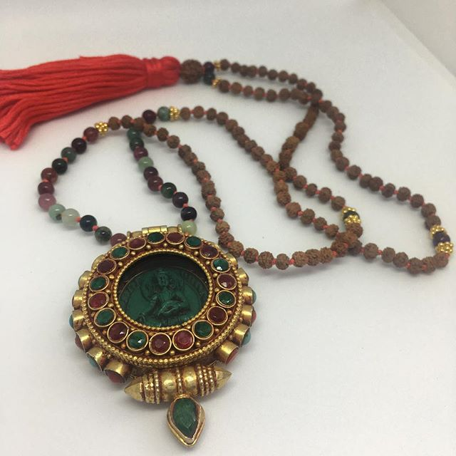 This beautiful ghau is set with natural rubies, emeralds, coral and turquoise. The Ghau is used as an amulet to help the wearer to ward off negative energy and attract blessings. A Ghau is used as a portable shrine and is worn close to the heart.  #rubies #emerald #coral #turquoise #ghau #gau #gemstones #gemstonejewelry #necklace #prayerbox #prayernecklace #prayer #alignwithyoursoul #align #mala #malashakti
