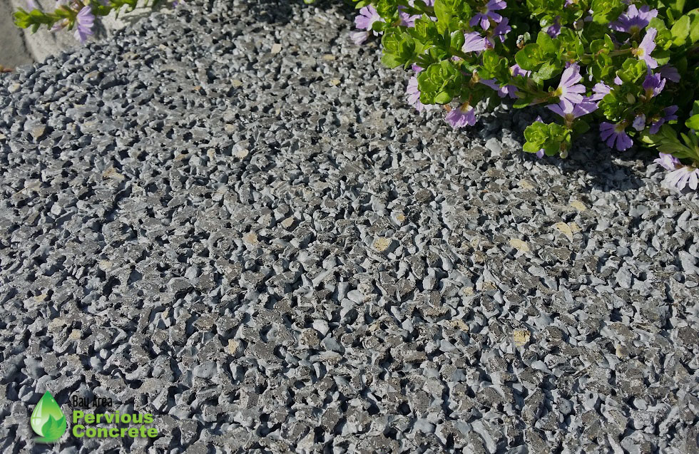 Decorative Colored Polished Pervious Concrete - Basalt aggregate with dark grey integral color