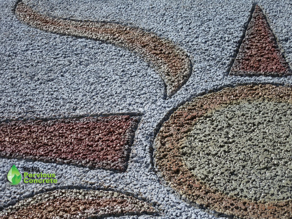 Decorative Stained Pervious Concrete - Custom stained sun design