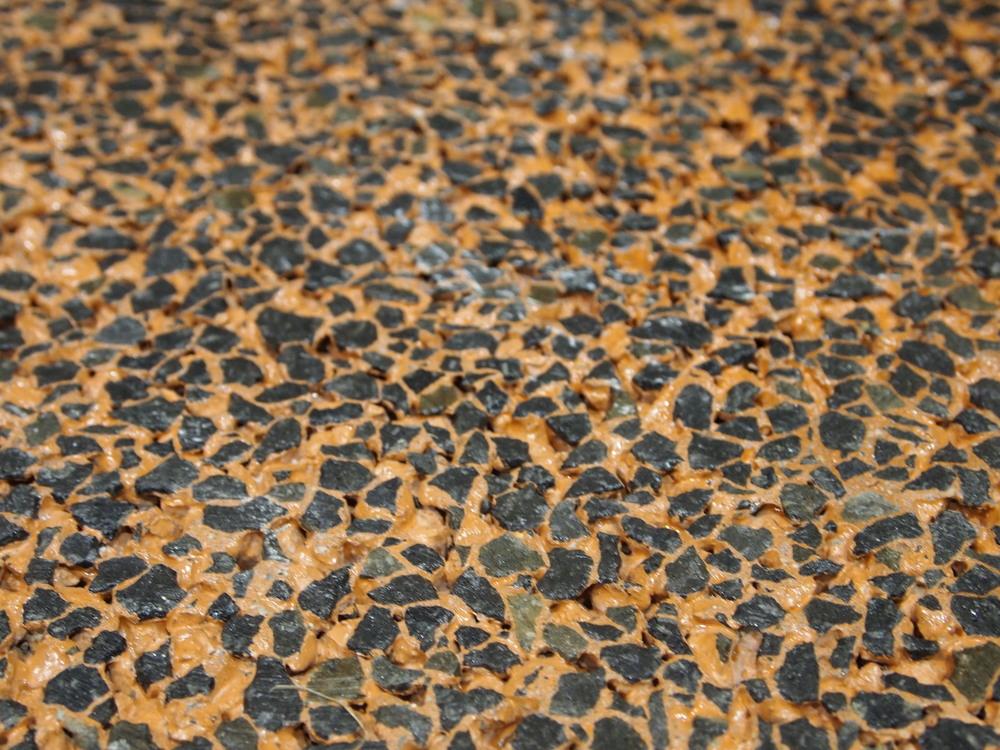 Decorative Colored Polished Pervious Concrete - Basalt aggregate with orange integral color