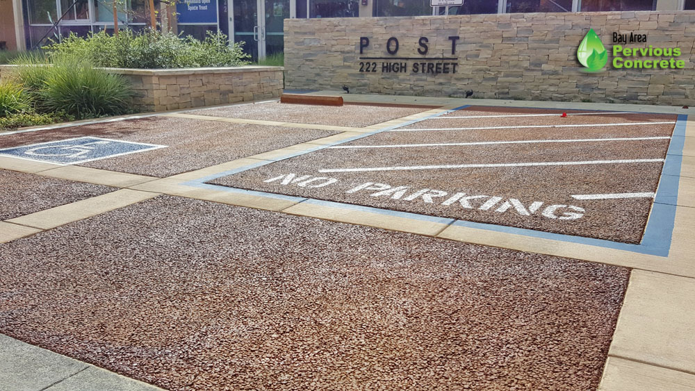 Classic Colored Pervious Concrete with traditional concrete border - Post St Office Parking Stalls - Palo Alto, CA