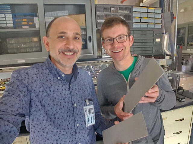 David Liguori and Dr. Thomas Murphy holding BAPC Pervious Concrete SABR ribs in NASA Ames Lab.