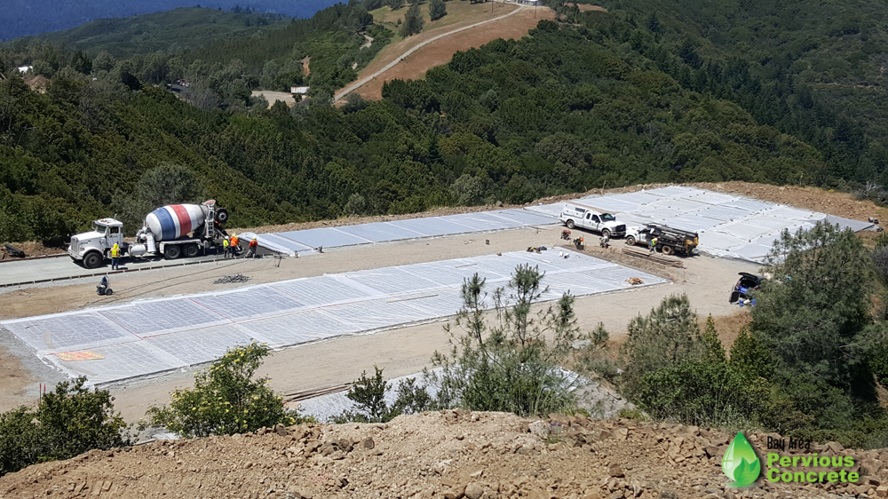 Pervious concrete helicopter pad and parking stalls being installed at Mt Umunhum Summit, curing under plastic.