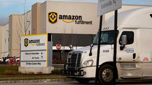 A truck drives past the Amazon.com fulfillment center in Robbinsville, New Jersey, Nov. 30, 2015. Michael Nagle | Bloomberg | Getty Images