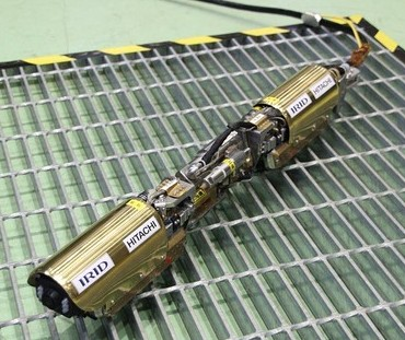 a custom snake-like inspection crawler designed specifically to navigate the complex interior of the FUKUSHIMA reactors. Equipped with a series of Inuktun's stainless steel Microtrac™ components, the remotely driven robot was made to slither through a four inch pipe, then dangle itself and descend on to a platform just below the reactor core's bottom.
