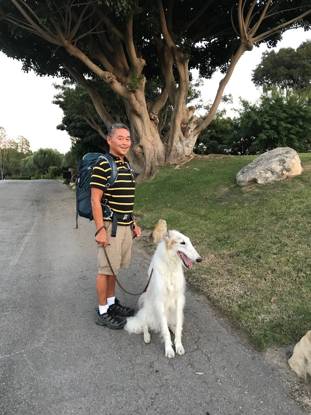 Here's Mike training with a 15 pound backpack while on a walk with Keesa.