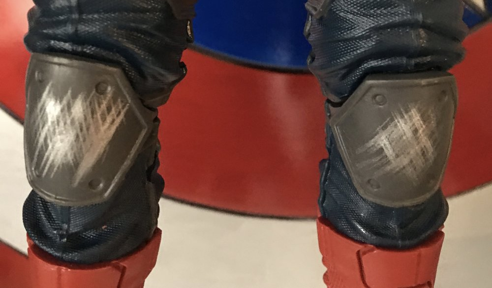 Scuffed knee pads show evidence of battle.