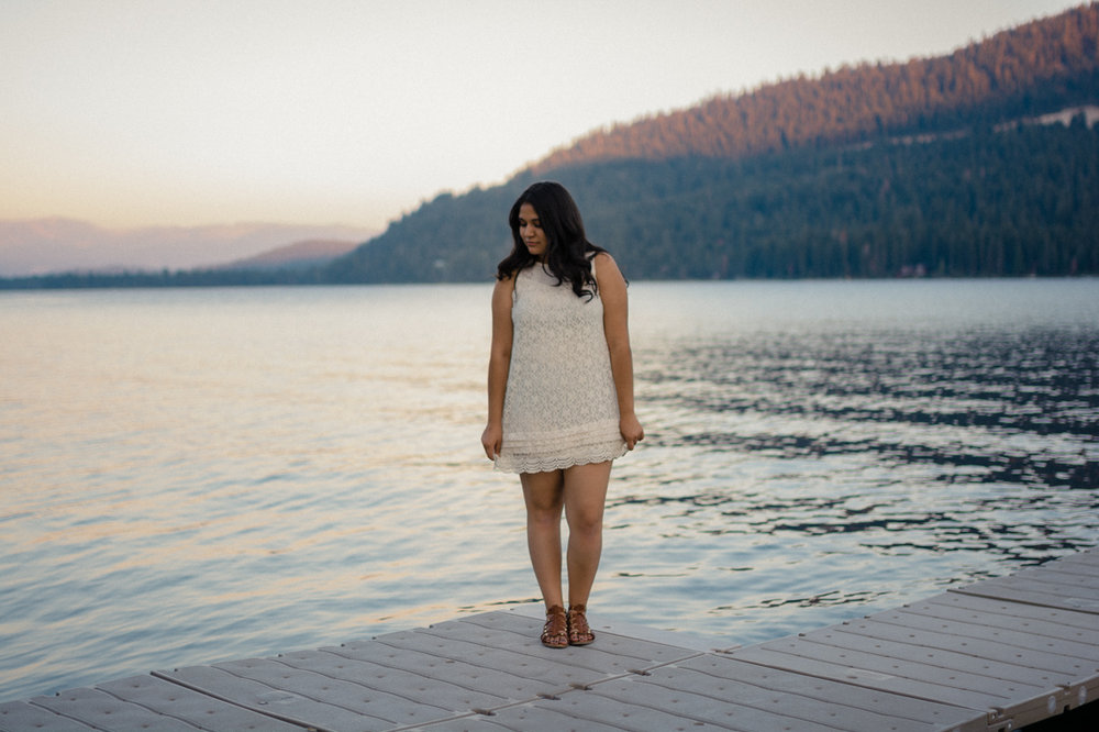 Lake Tahoe senior pictures of a girl standing on a dock at Donner Lake