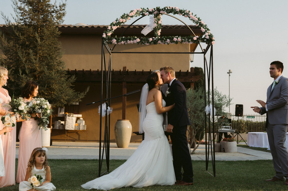 California Wedding private venue bride and grooms first kiss
