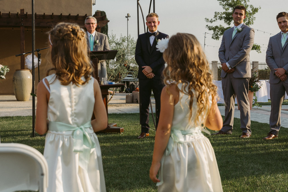 California Wedding private venue flower girls walking down the aisle photo