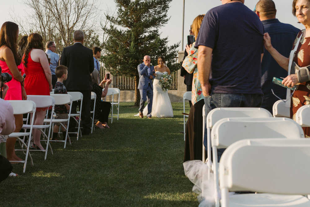California Wedding private venue bride talking down the aisle photo