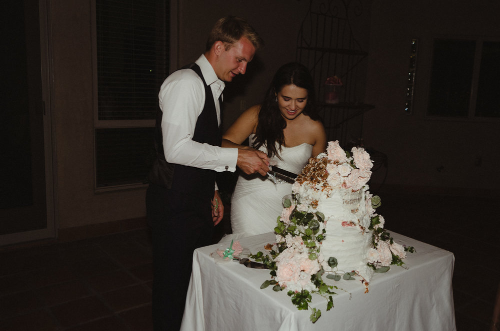 California Wedding private venue  bride and groom cutting the cake photo
