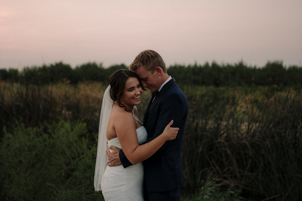 California Wedding private venue bride and groom hugging photo