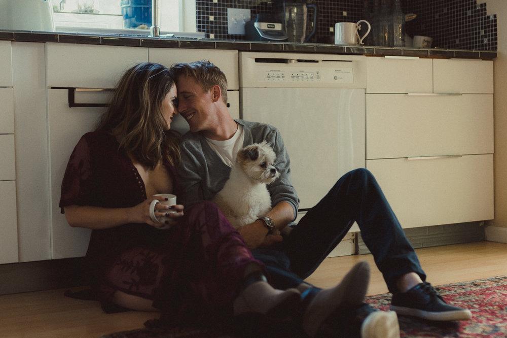 Reno Lifestyle couple sitting on the kitchen floor photo